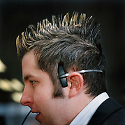 Rob Watson, call centre operative. Robs individual hair suggest a life outside work that is more fun, at least maybe that is the intended impression. Office workers have little opportunity to express themselves because of the constraints of the office dress code. From the series Desk Job, a project which explores globalisation through office life around the World.