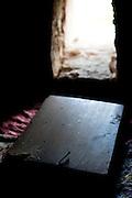 Open window on the altar of the 10th century Byzantine chapel of Agios Stefanos, Drakona, Crete, Greece