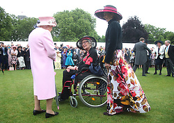 Queen Elizabeth II meeting Margaret Baxter (centre), aged 96, from Suffolk, who previously met the Queen at the end of the Second World War in Portsmouth when she was serving in the Auxiliary Service (ATS), during a Royal Garden Party at Buckingham Palace in London.
