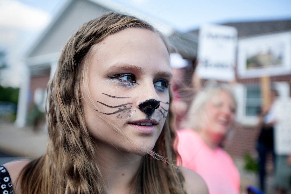 Paige Ellgren, 17, of Bloomington attended the protest outside of the dental office of Walter James Palmer in Bloomington, MN, July 29, 2015.  She said she has strong feelings about protecting animals and feels that Palmer killing Cecil the lion was wrong.