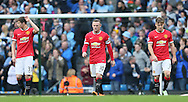 Paddy McNair, Wayne Rooney and Luke Shaw of Manchester United walk back dejected following the City opening goal - Barclays Premier League - Manchester City vs Manchester Utd - Etihad Stadium - Manchester - England - 2nd November 2014  - Picture David Klein/Sportimage