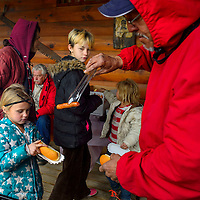 022815  Adron Gardner/Independent<br /> <br /> Sarah byington,6, left, awaits a hot dog cooked by Ruben Alvarez, as Allyssa Janca, 11, center, looks on at the Candy Kitchen Trading Post Saturday.