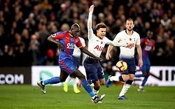 Crystal Palace's Mamadou Sakho (left) and Tottenham Hotspur's Dele Alli (centre) battle for the ball during the Premier League match at Selhurst Park, London.