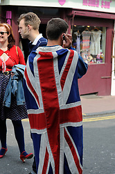 Brighton, UK. 29/04/2011. The Royal Wedding of HRH Prince William to Kate Middleton. Man wearing a Union Flag. Photo credit should read: Peter Webb/LNP. Please see special instructions for licensing information. © under license to London News Pictures