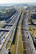 Nederland, Zuid-Holland, Rotterdam, 18-02-2015. A15 ter hoogte van Hoogvliet en Pernis. De constructie direct naast de snelweg is het nieuwe leidingenviaduct, aangelegd omdat er geen ruimte voor uitbreiding van de leidingstrook in de ondergrond is. Rechts de Betuweroute en ingang Botlek spoortunnel.<br /> Motorway A5, hinterland connection. Next to the motorway the pipeline overpass, recently build because of lack of space in the ground.<br /> luchtfoto (toeslag op standard tarieven);<br /> aerial photo (additional fee required);<br /> copyright foto/photo Siebe Swart