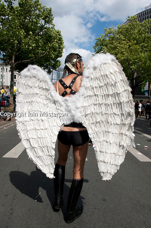 Man wearing angel wings at Christopher Street Day Parade in Berlin Germany 2011