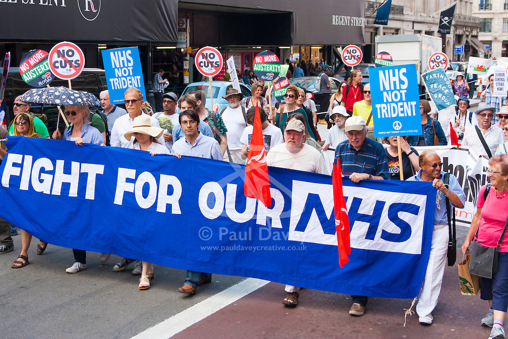 London, June 21st 2014. Protesters demand an end to cuts and privatisation which they say are destroying the NHS.
