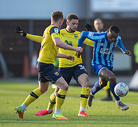 Blackpool's Marc Bola (right) under pressure from Oxford United's Sam Long (left) and Marcus Browne (centre)<br /> <br /> Photographer David Horton/CameraSport<br /> <br /> The EFL Sky Bet League One - Oxford United v Blackpool - Saturday 1st February 2020 - Kassam Stadium - Oxford<br /> <br /> World Copyright © 2020 CameraSport. All rights reserved. 43 Linden Ave. Countesthorpe. Leicester. England. LE8 5PG - Tel: +44 (0) 116 277 4147 - admin@camerasport.com - www.camerasport.com