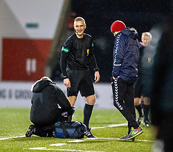 Ref Mike Ronocone gets some treatment during the second half. Airdrie 0 v 1 Arbroath, Scottish Football League Division One played 15/12/2018 at Airdrie's Excelsior stadium.