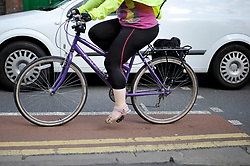 Embargoed to 0001 Monday November 19 File photo dated 07/08/13 of a person cycling in Bristol. People who travel on two wheels are 63 times more likely to be killed or seriously injured (KSI) than car drivers, according to new research.