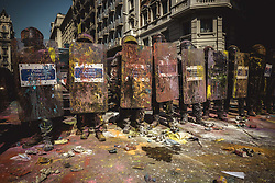 September 29, 2018 - Catalonia, Spain - Catalan riot police agents stand guard as they are colored by paint bags thrown from pro-independence activists protesting agsinst s demonstrstion of Police officers of the National Police and Civil Guard marching through Barcelona to pay homage to the participants of last years 'operacion copernico', a massive police deployment within the Catalan secession referendum at October 1st, and to protest for a salary equality with the regional police forces (Credit Image: © Matthias OesterleZUMA Wire)