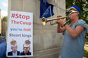 Pro remain protester playing a trumpet  in Westminster on the day that Parliament reconvenes after summer recess to debate and vote on a bill to prevent the UK leaving the EU without a deal at the end of October, on 3rd September 2019 in London, England, United Kingdom.
