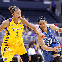 17 June 2014: Minnesota Lynx forward Maya Moore (23) drives to the basket past Los Angeles Sparks forward/center Candace Parker (3) during the Minnesota Lynx  94-77 victory over the Los Angeles Sparks, at the Staples Center, Los Angeles, California, USA.
