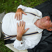 Frank Wood, of Wallace, North Carolina, gets a quick nap in, before educating visitors as a living historian at a Confederate encampment, during the Sesquicentennial Anniversary of the Battle of Gettysburg, Pennsylvania on Wednesday, July 3, 2013.  The Battle of Gettysburg lasted from July 1-3, 1863 resulting in over 50,000 soldiers killed, wounded or missing.  John Boal Photography