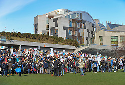 School pupils walked out of classes on Friday to protest at the effects of climate change. They rallied at the Scottish Parliament.<br /> <br /> © Dave Johnston / EEm
