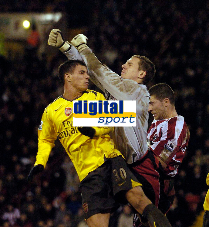 Photo: Jed Wee.<br />Sheffield United v Arsenal. The Barclays Premiership. 30/12/2006.<br /><br />Stand in goalkeeper Phil Jagielka (C) jumps to punch a ball away from Arsenal's Jeremie Aliadiere.