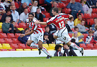 Photo: Leigh Quinnell.<br /> Watford v Sheffield United. Coca Cola Championship.<br /> 17/09/2005. Sheffield Uniteds Nick Montgomery runs to congratulate Paul Ifill on his goal.