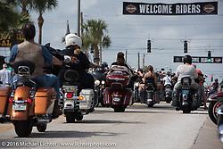 Riding down Main Street during Daytona Bike Week's 75th Anniversary event. FL, USA. Saturday March 12, 2016.  Photography ©2016 Michael Lichter.