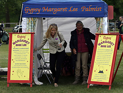 Autumn Phillips (left) has her fortune told during the Royal Windsor Horse Show, which is held in the grounds of Windsor Castle in Berkshire.