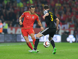 Nicolas Lombaerts of Belgium (Zenit Saint Petersburg) fouls Gareth Bale of Wales (Real Madrid) - Photo mandatory by-line: Alex James/JMP - Mobile: 07966 386802 - 12/06/2015 - SPORT - Football - Cardiff - Cardiff City Stadium - Wales v Belgium - Euro 2016 qualifier