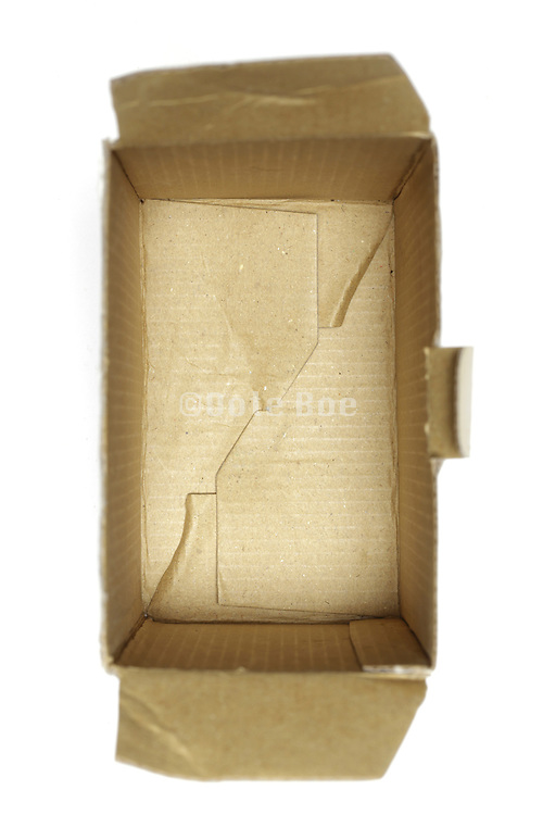 still life of an opened carton box with cover off