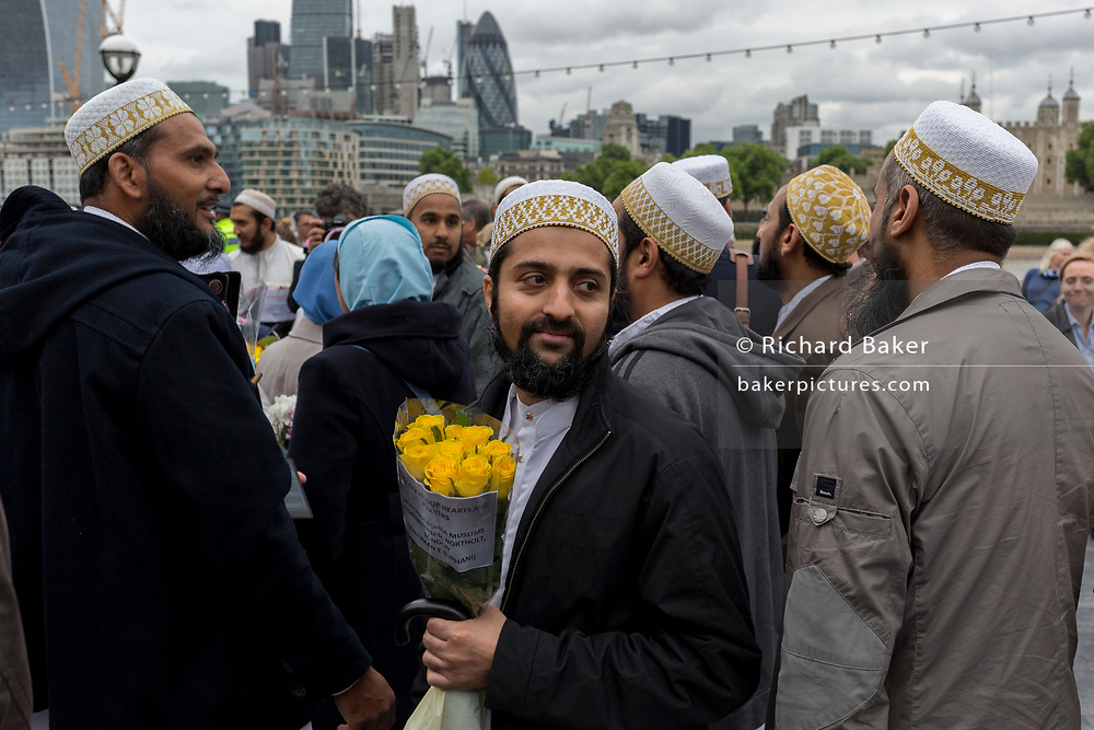 Two days after the London Bridge and Borough Market terrorist attack, Londoners from all faiths and religions attended a vigil outside City Hall, on Monday 5th June 2017, in the south London borough of Southwark, England. A prominent armed police presence guarded dignitaries and the public who came to the Southbank to remember the seven killed and many others left with life-changing injuries. The British spirit of defiance and to carry on with every day life, endures. (