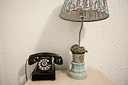 A light and telephone on a bedside stand at the Blue Swallow Motel in Tucumcari, New Mexico. Missoula Photographer