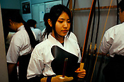 A student at a Kyudo dojo in Kyoto, Japan.Kyudo is a modern Japanese martial art derived from ancient Samurai archery, heavily influenced by Zen Buddhist philosophy.