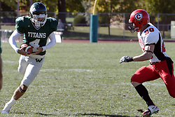 07 October 2006: Jordan Mussleman dodges Aaron Miller. The Titans of Illinois Wesleyan University started off strong with a touchdown on the 2nd play from scrimmage in the game.  The Titans led most of the way, but failed to maintain the lead in the 4th quarter giving up the decision of this CCIW conference game to the Red Men of Carthage by a score of 31 - 28. Action was at Wilder Field on the campus of Illinois Wesleyan University in Bloomington Illinois.<br />