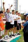 Policeman presenting 1st place medal to exuberant athlete. Special Olympics U of M Bierman Field. Minneapolis Minnesota USA