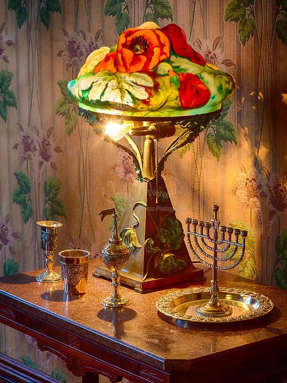 Small table with lamp and silver menorah in a Jewish home in Dallas, Texas from the turn of the 20th century