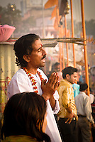 A pilgrim prays on the ghats during the festival of Kartik Poornima in Varanasi, Uttar Pradesh, India