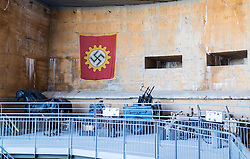 24.06.2016, Audinghen, FRA, Museum der Batterie Todt am Atlantikwall, im Bild Punker Innenansicht mit einer Hakenkreuz Flagge // The Todt Battery is a battery of coastal artillery built by the Germans in World War II. It was one of the most important coastal fortifications of the Atlantic Wall, and consisted of four 380 mm calibre Krupp guns with a range up to 55.7 km, capable of reaching the British coast, and each protected by a bunker of reinforced concrete, Audinghen, France on 2016/06/24. EXPA Pictures © 2016, PhotoCredit: EXPA/ JFK