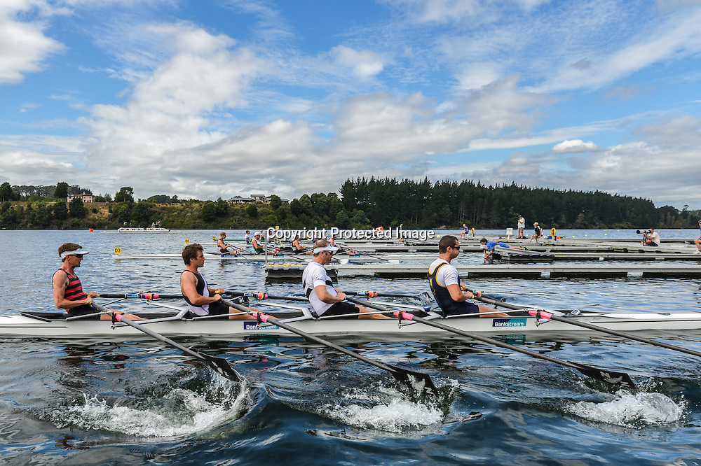 New Zealand Rowing National Championships, Lake Karapiro, 20 February 2014 The Auckland Regional Performance crew of Michael Arms, Mahe Drysdale, Giacomo Thomas and Peter Taylor leave the start of the Mens Premiere Quad