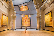Double Space for BMW by Barber + Osgerby -<br /> Leading design duo, Edward Barber and Jay Osgerby worked with BMW to present a kinetic, silvered structure which is suspended from the ceiling of the Raphael Gallery at the V&A. The installation rotates to create a 'beguiling' reflection of the room, the art and the viewers on the ground. <br /> The London Design Festival at the V&A, South Kensington, London 12 Sept 2014. Guy Bell, 07771 786236, guy@gbphotos.com