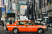 A bright orange Japanese taxi in Ginza, Tokyo, Japan. Wednesday February 5th 2020