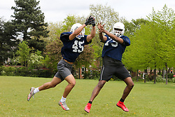 © Licensed to London News Pictures. 09/05/2021. London, UK. Members of London Blitz American Football team practice in Finsbury Park, north London. According to the Met Office, a temperature of 20 degrees celsius is expected on Sunday.  <br /> <br /> *** Permission Granted *** <br /> <br /> Photo credit: Dinendra Haria/LNP