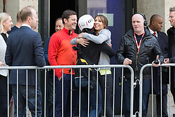 "© Licensed to London News Pictures. 10/06/2015. London, UK. Emma Willis hugs Alex Jones before taking part in a ""leap of faith"" stunt at the new BBC Broadcasting House. Photo credit : Vickie Flores/LNP"