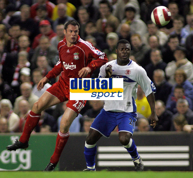 Photo: Paul Thomas.<br /> Liverpool v Middlesbrough. The Barclays Premiership. 18/04/2007.<br /> <br /> Jamie Carragher (L) battles with Yakubu of Boro.