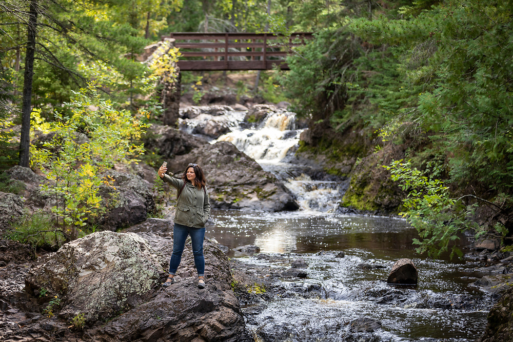 Judy Roemer take a selfie at Amnicon Falls near Superior, Wisconsin. Photo by Mike Roemer
