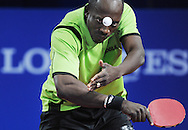 Commonwealth Games, Glasgow 2014<br /> Scotstoun Table Tennis<br /> Mens Bronze Medal Match<br /> India v Nigeria<br /> Toriola Segun of Nigeria during his singles match versus Achanta S.K of India<br /> <br />  Neil Hanna Photography<br /> www.neilhannaphotography.co.uk<br /> 07702 246823