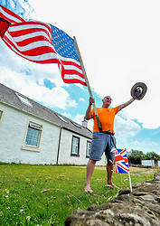 Pictured: Trump supporter and Turnberry resident Bill McGibbon shows his support for the controversial President.<br /> <br /> Protesters gathered amid tight security at the Trump Turnberry resort, where President Trump and his wife Melania are staying on their trip to Scotland.<br /> <br /> © Dave Johnston / EEm
