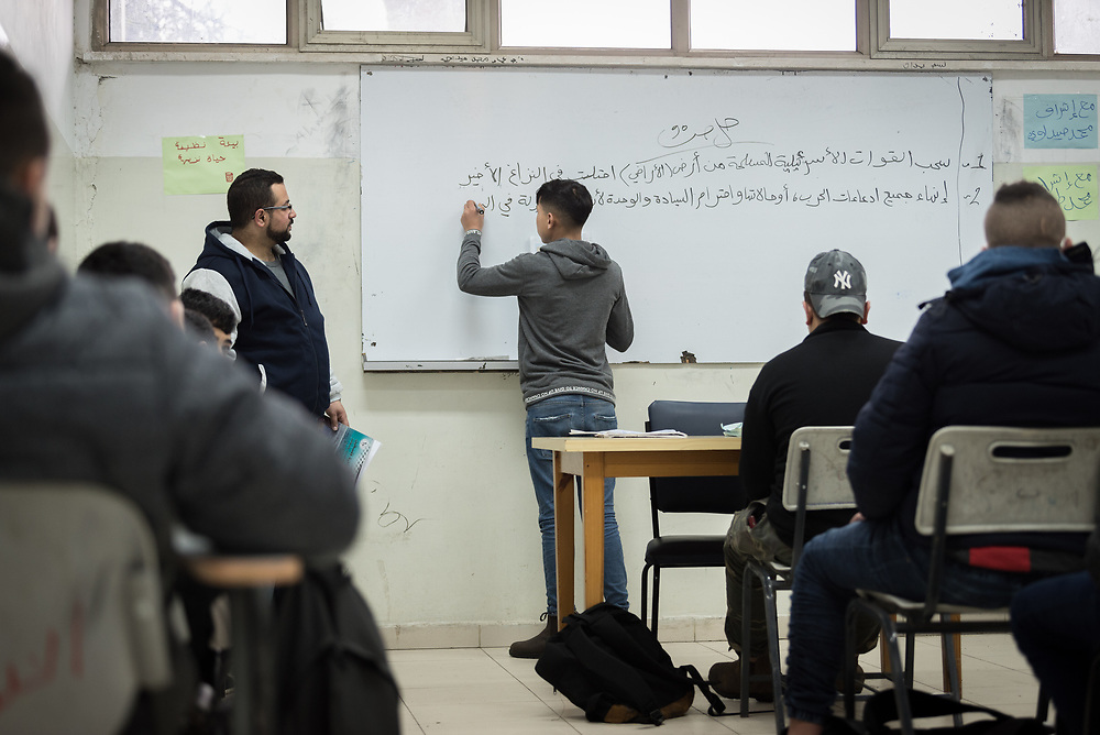 25 February 2020, Jerusalem: History class for students in the 10th grade is underway, under the leadership of teacher Ahmad Sharef. The Lutheran World Federation's vocational training centre in Beit Hanina offers vocational training for Palestinian youth across a range of different professions, providing them with the tools needed to improve their chances of finding work.