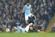17 Kevin De Bruyne and 26 Riyad Mahrez for Manchester City tangle with Rotherham United midfielder Ryan Williams (23) during the The FA Cup 3rd round match between Manchester City and Rotherham United at the Etihad Stadium, Manchester, England on 6 January 2019.