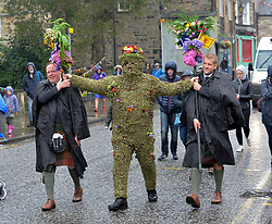 Pictured: Burryman Andrew Taylor sets off on his tour of the town with his attendants and followers.<br /> <br /> The folklore character the Burryman carried out his annual walk through the streets of Queensferry to mark the start of the Ferry Fair, traditionally having a glass of whisky at every bar on the route. Covered head to toe in over 20,000 burrs, the tradition dates back hundreds of years.<br /> <br /> © Dave Johnston / EEm