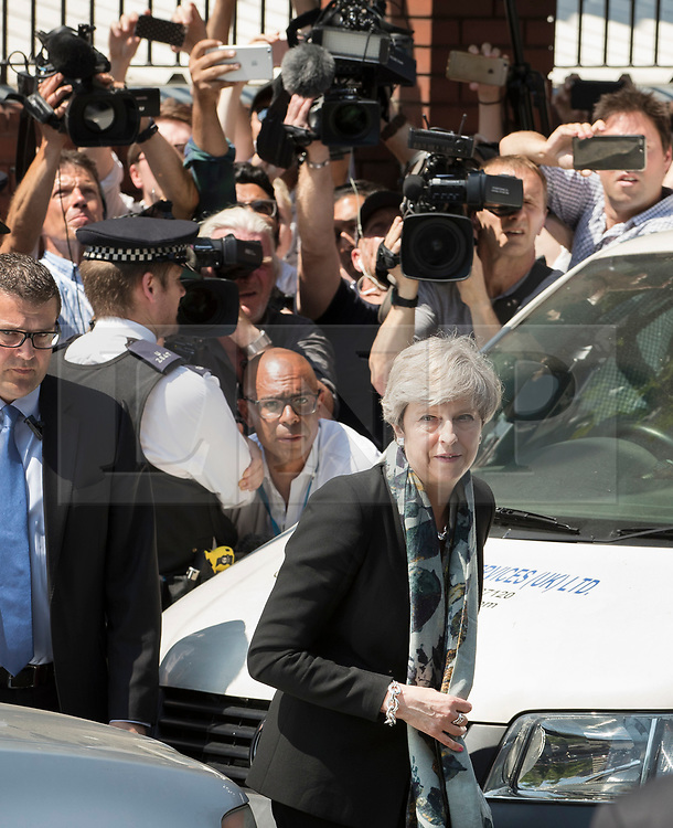 © Licensed to London News Pictures. 19/06/2017. London, UK. Prime Minister Theresa May leaves Finsbury Park Mosque in north London where earlier a van ploughed into a crowd near Finsbury Park Mosque, as they finished taraweeh, Ramadan evening prayers. One person has been killed and 10 people are injured. Photo credit: Peter Macdiarmid/LNP