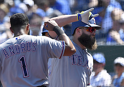 July 16, 2017 - Kansas City, MO, USA - Texas Rangers' Mike Napoli is congratulated by Elvis Andrus after Napoli hit a solo home run in the seventh inning during Sunday's baseball game against the Kansas City Royals at Kauffman Stadium in Kansas City, Mo. (Credit Image: © John Sleezer/TNS via ZUMA Wire)