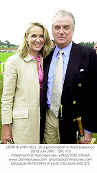 LORD & LADY BELL  at a polo match in West Sussex on 22nd July 2001.<br />ORL 113
