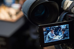 Norwegian reigning champion Magnus Carlson (left) and American challenger Fabiano Caruana are seen on a television camera viewfinder during their tie-break matches at the FIDE World Chess Championship match, at the College, in Holborn, London.