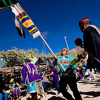 102712       Cable Hoover<br /> <br /> Carlen Seowtewa carries the harvest staff during the Zuni Harvest Festival dance in Zuni's middle village Saturday.